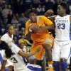 Photo - Tennessee's Jasmine Jones, middle, looks for an opening between Kentucky's Janee Thompson (3) and Samarie Walker (23) during the second half of an NCAA college basketball game at Memorial Coliseum in Lexington, Ky., Sunday, March 3, 2013. Kentucky defeated Tennessee 78-65. (AP Photo/James Crisp)
