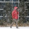 A Pedestrian walks on Park Avenue as snow moves into the downtown area of Oklahoma City, Thursday December 5, 2013. Photo By Steve Gooch, The Oklahoman