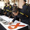 Grambling women\'s basketball player Tonishea Mack signs a memorial banner for OSU women\'s head coach Kurt Budke and assistant coach Miranda Serna at Gallagher-Iba Arena in Stillwater, Okla., Friday, Nov. 18, 2011. Photo by Sarah Phipps, The Oklahoman
