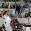Kevin Durant, right, drives with the ball past Spain\'s Rudy Fernandez during Sunday\'s game. AP PHOTO