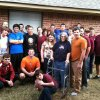 Photo - The Edmond Memorial baseball team surrounds the Gallaher family -- David, Sharon and Brandon -- after delivering donations to the family last Wednesday. Provided photo