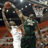 South Florida Bulls\' Kore White (33) blocks a shot by Oklahoma State \'s Kamari Murphy (21) during the college basketball game between Oklahoma State University (OSU) and the University of South Florida (USF) on Wednesday , Dec. 5, 2012, in Stillwater, Okla. Photo by Chris Landsberger, The Oklahoman