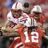 Nebraska running back Rex Burkhead protects the ball against Wisconsin defensive back Dezmen Southward (12) during the first half of the Big Ten championship NCAA college football game Saturday, Dec. 1, 2012, in Indianapolis. (AP Photo/Michael Conroy)
