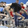 Classen\'s Chelsea Ye pushes away from the starting block in the girl\'s 100 yard freestyle during the 5A State Swimming finals at Oklahoma City Community College in Oklahoma City, OK, Saturday, Feb. 18, 2012. By Paul Hellstern, The Oklahoman