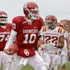 Iowa State safety Ter\'Ran Benton (22) looks on as Oklahoma quarterback Blake Bell celebrates a touchdown in the second quarter of an NCAA college football game in Norman, Okla., Saturday, Nov. 26, 2011. (AP Photo/Sue Ogrocki) ORG XMIT: OKSO105