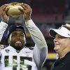 Oregon\'s Michael Clay, left, holds up the championship trophy as head coach Chip Kelly looks on after the Fiesta Bowl NCAA college football game against Kansas State Thursday, Jan. 3, 2013, in Glendale, Ariz. Oregon defeated Kansas State 35-17.(AP Photo/Ross D. Franklin)
