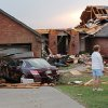 Neighbors stand in the front yard of one of the eight homes damaged or destroyed on Broadway in a neighborhood surrounding the Cedar Valley East Golf Course after a tornado came through the area Tuesday afternoon, May 24, 2011, Photo by Jim Beckel, The Oklahoman