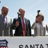 Photo - State of Chihuahua, Mexico, Governor Cesar Duarte, left, U.S. Sen. Tom Udall, center, and New Mexico Governor Susana Martinez hammer golden spikes during a railroad hub opening ceremony in Santa Teresa, New Mexico, Wednesday, May 28, 2014. A sprawling $400 million railroad hub opened in this border town and it is expected to create up to 600 jobs and attract businesses. (AP Photo/Juan Carlos Llorca)