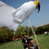 Photo -  UCO: Dillon Slater, 12, of Oklahoma City, (front) and Nate Elix, 16, help carry a dove during the Pinwheels for Peace Festival at Plunkett Park on the campus of the University of Central Oklahoma in Edmond on Sunday, Sept. 19, 2010. Photo by John Clanton, The Oklahoman ORG XMIT: KOD