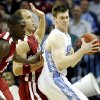 Oklahoma\'s Juan Pattillo (12) and Taylor Griffin (32) defend on North Carolina\'s Tyler Hansbrough (50) during the second half in the Elite Eight game of NCAA Men\'s Basketball Regional between the University of North Carolina and the University of Oklahoma at the FedEx Forum on Sunday, March 29, 2009, in Memphis, Tenn. PHOTO BY CHRIS LANDSBERGER, THE OKLAHOMAN