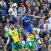 Photo - Chelsea's Eden Hazard, right, out jumps Norwich City's Robert Snodgrass during their English Premier League soccer match between Chelsea and Norwich City at Stamford Bridge stadium in London Sunday, May 4, 2014. (AP Photo/Alastair Grant)
