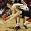 Oklahoma\'s Morgan Hook (10) tries to keep the ball away from Cal State Northridge\'s Marta Masoni (24) in the first half during a women\'s college basketball game between the University of Oklahoma (OU) and Cal State Northridge at the Lloyd Noble Center in Norman, Okla., Saturday, Dec. 29, 2012. Photo by Nate Billings, The Oklahoman