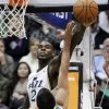 Utah Jazz\'s Marvin Williams (2) blocks the shot of New Orleans Hornets\' Greivis Vasquez (21), of Venezuela, in the second quarter during an NBA basketball game Wednesday, Jan. 30, 2013, in Salt Lake City. (AP Photo/Rick Bowmer)
