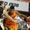 Oklahoma State\'s Marcus Smart tries to get around Ottawa\'s Stephen Feighny during the college basketball game between Oklahoma State University and Ottawa (Kan.) at Gallagher-Iba Arena in Stillwater, Okla., Thursday, Nov. 1, 2012. Photo by Sarah Phipps, The Oklahoman