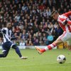 Photo - West Bromwich Albion's Stephane Sessegnon, left, scores his sides first goal during their English Premier League soccer match against Stoke City at The Hawthorns, West Bromwich, England, Sunday, May 11, 2014. (AP Photo/Joe Giddens, PA Wire)    UNITED KINGDOM OUT   -   NO SALES   -   NO ARCHIVES