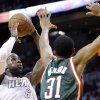 Photo - Miami Heat forward LeBron James (6) shoots against Milwaukee Bucks forward John Henson (31) during the first half of Game 2 in their first-round NBA basketball playoff series, Tuesday, April 23, 2013 in Miami. (AP Photo/Wilfredo Lee)