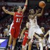 Oklahoma\'s Aaryn Ellenberg (3) shoots a basket as Marist\'s Leanne Ockenden (11) defends during the women\'s college basketball game between the University of Oklahoma and Marist at Lloyd Noble Center in Norman, Okla., Sunday,Dec. 2, 2012. Photo by Sarah Phipps, The Oklahoman