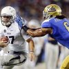 UCLA\'s Eric Kendricks, right, pushes Nevada quarterback Cody Fajardo out of bounds during the first half of an NCAA college football game in Pasadena, Calif., Saturday, Aug. 31, 2013. (AP Photo/Chris Carlson)