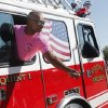 Firefighter Vernon Boyce throws candy out of a firetruck during the Red Ribbon Parade in Moore Saturday, October 29, 2011. Photo by Doug Hoke, The Oklahoman