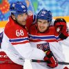 Photo - Czech Republic forward Roman Cervenka, right, celebrates his goal with forward Jaromir Jagr during the first period of the 2014 Winter Olympics men's ice hockey game against Slovakia at Shayba Arena, Tuesday, Feb. 18, 2014, in Sochi, Russia. (AP Photo/Petr David Josek)