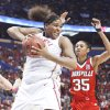 Courtney Paris pulls in a rebound in front of Louisville's Angel McCoughtry during OU's 61-59 loss Sunday at the Scottrade Center in St. Louis. OU jumped out to an early 11-0 lead, but Louisville fought back and won to advance to the finals. Photo by Steve Sisney, The Oklahoman