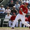 Photo - Los Angeles Angels' Raul Ibanez hits a home run during the second inning of an exhibition spring training baseball game against the Texas Rangers Tuesday, March 4, 2014, in Tempe, Ariz. (AP Photo/Morry Gash)