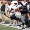 Oklahoma State\'s Isaiah Anderson (82) is forced out of bounds by Texas Tech\'s Daniel Cobb (42) during a college football game between Texas Tech University (TTU) and Oklahoma State University (OSU) at Jones AT&T Stadium in Lubbock, Texas, Saturday, Nov. 12, 2011. Photo by Sarah Phipps, The Oklahoman ORG XMIT: KOD