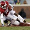 Oklahoma\'s Jalen Saunders (18) is pulled down by Oklahoma State\'s Daytawion Lowe (8) during the second half of the Bedlam college football game in which the University of Oklahoma Sooners (OU) defeated the Oklahoma State University Cowboys (OSU) 51-48 in overtime at Gaylord Family-Oklahoma Memorial Stadium in Norman, Okla., Saturday, Nov. 24, 2012. Photo by Steve Sisney, The Oklahoman