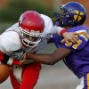 Western Heights\' James Lewis fumbles the ball as Northwest Classen\'s Terrance Bias brings him down during a high school football game at Taft Stadium in Oklahoma City, Thursday, September 20, 2012. Photo by Bryan Terry, The Oklahoman