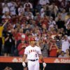 Los Angeles Angels\' Albert Pujols gets set to bat during the first inning of a baseball game against the Kansas City Royals, Friday, April 6, 2012, in Anaheim, Calif. (AP Photo/Mark J. Terrill)