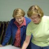 Harrah residents Shirley Thompson and Doris Pettiet look to sign the