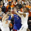 Oklahoma State \'s Phil Forte (13) and Kamari Murphy (21) defend on Kansas\' Jeff Withey (5) during the college basketball game between the Oklahoma State University Cowboys (OSU) and the University of Kanas Jayhawks (KU) at Gallagher-Iba Arena on Wednesday, Feb. 20, 2013, in Stillwater, Okla. Photo by Chris Landsberger, The Oklahoman