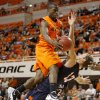 Oklahoma State\'s Reger Dowell (5) runs into Texas-San Antonio\'s Igor Nujic (13)during an NCAA college basketball game between the Oklahoma State University Cowboys (OSU) and the University of Texas-San Antonio Roadrunners at Gallagher-Iba Arena in Stillwater, Okla., Wednesday, Nov. 16, 2011. Photo by Bryan Terry, The Oklahoman