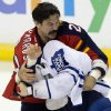 Florida Panthers\' George Parros, rear, and Toronto Maple Leafs\' Colton Orr fight during the first period of an NHL hockey game in Sunrise, Fla., Monday, Feb. 18, 2013. (AP Photo/J Pat Carter)