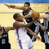 Oklahoma City\'s Kevin Durant (35) takes the ball to the basket in the fourth quarter as he is defended by San Antonio\'s Tim Duncan (21), Kawhi Leonard (2) and San Antonio\'s Danny Green (4) during Game 6 of the Western Conference Finals in the NBA playoffs between the Oklahoma City Thunder and the San Antonio Spurs at Chesapeake Energy Arena in Oklahoma City, Saturday, May 31, 2014. Photo by Nate Billings, The Oklahoman