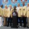 Photo - FILE - In this Aug. 8, 2009, file photo, Ralph Wilson Jr., fourth from left, owner of the Buffalo Bills, poses with his bust and former Buffalo Bills players, from left, Bruce Smith, Thurman Thomas, Marv Levy, Joe DeLamielleure, James Lofton, Billy Shaw and Jim Kelly during the Pro Football Hall of Fame induction ceremony at the Pro Football Hall of Fame in Canton, Ohio. Bills owner Wilson Jr. has died at the age of 95 at his home in Grosse Pointe Shores, Mich. NFL.com says team president Russ Brandon announced his death at the league's annual meeting in Orlando, Fla., Tuesday, March 25, 2014. He was one of the original founders of the American Football League and owned the Bills for the last 54 years. (AP Photo/Tony Dejak, File)