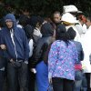 Family members speak with members of the Baltimore City Fire Department at the scene of an early morning fire claimed that claimed the lives of an adult and four children in Baltimore, Thursday, Oct. 11, 2012. (AP Photo/Patrick Semansky)