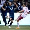Photo - Vancouver Whitecaps' Kenny Miller, left, of Scotland, defends against New York Red Bulls' Eric Alexander during first half MLS soccer action in Vancouver, B.C., on Saturday, March 8, 2014.  (AP Photo/The Canadian Press, Darryl Dyck)
