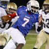 Millwood\'s Kevonte Richardson (7) gets past Kingfisher\'s Rhett Blundell (31) and Joe Gaither (63) during the Class 2A State semifinal football game between Millwood High School and Kingfisher High School on Saturday, Dec. 5, 2009, in Yukon, Okla. Photo by Chris Landsberger, The Oklahoman