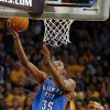Oklahoma City\'s Kevin Durant (35) takes a shot next to Los Angeles\' Matt Barnes (9) during Game 3 in the second round of the NBA basketball playoffs between the L.A. Lakers and the Oklahoma City Thunder at the Staples Center in Los Angeles, Saturday, May 19, 2012. Photo by Nate Billings, The Oklahoman