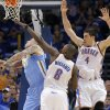 Oklahoma City\'s Nazr Mohammed (8) and Oklahoma City\'s Nick Collison (4) defend on Denver\'s Chris Andersen (11) during the first round NBA playoff game between the Oklahoma City Thunder and the Denver Nuggets on Sunday, April 17, 2011, in Oklahoma City, Okla. Photo by Chris Landsberger, The Oklahoman