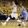 Golden State Warriors\' Stephen Curry, left, drives the ball past Denver Nuggets\' Andre Miller during the second half of Game 4 in a first-round NBA basketball playoff series on Sunday, April 28, 2013, in Oakland, Calif. (AP Photo/Ben Margot)