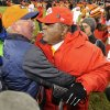 Photo - Denver Broncos head coach John Fox, left, greets Kansas City Chiefs coach Romeo Crennel at the end of an NFL football game, Sunday, Dec. 30, 2012, in Denver. Denver won 38-3. (AP Photo/Jack Dempsey)