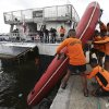 Photo - Philippine Coast Guard divers transfer a rubber boat as they prepare to be deployed to augment rescue operations in Cebu from their headquarters in Manila, Philippines on Saturday, Aug. 17, 2013. A ferry with more than 800 people aboard sank near the central Philippine port of Cebu after colliding with a cargo vessel, killing at least 28 people. Hundreds have been rescued but more than 200 are still missing, the coast guard said Saturday. (AP Photo/Aaron Favila)