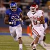 Oklahoma\'s Dominique Whaley (8) leaps past Kansas\' Steven Johnson (52) during the college football game between the University of Oklahoma Sooners (OU) and the University of Kansas Jayhawks (KU) at Memorial Stadium in Lawrence, Kansas, Saturday, Oct. 15, 2011. Photo by Bryan Terry, The Oklahoman