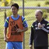 Photo - Japan's Shinji Kagawa, left, works out beside team coach Alberto Zaccheroni during a training session of Japan in Itu, Brazil, Sunday, June 22, 2014.  Japan play in group C of the 2014 soccer World Cup. (AP Photo/Shuji Kajiyama)