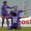 Photo -   Fiorentina's Luca Toni, center, celebrates with teammates Alberto Aquilani, back to camera, and Juan Cuadrado, of Colombia, after scoring during a Serie A soccer match between Fiorentina and Atalanta at the Artemio Franchi stadium in Florence, Italy, Sunday Nov. 18, 2012. (AP Photo/Fabrizio Giovannozzi)