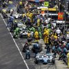 Photo - James Hinchcliffe, of Canada, (27) and others pit during the 98th running of the Indianapolis 500 IndyCar auto race at the Indianapolis Motor Speedway in Indianapolis, Sunday, May 25, 2014. (AP Photo/Darron Cummings)
