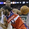 Photo - Washington Wizards' Nene (42) drives to the basket as Utah Jazz's Derrick Favors, rear, defends during the second quarter of an NBA basketball game Saturday, Jan. 25, 2014, in Salt Lake City. (AP Photo/Rick Bowmer)