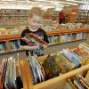 Cooper Dennehy, 6, of Oklahoma City, looks at a book Wednesday in the children's area at the Southwest Oklahoma City Public Library. Photo by Paul B. Southerland, The Oklahoman